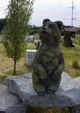 Sculpture of bear. The sculpture of the bear and two bear on the rocks Stock Images
