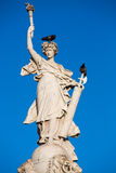 Sculpture and birds with blue sky Stock Photography