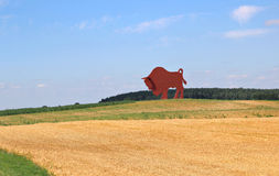 Sculpture of the bison in a field Stock Photography