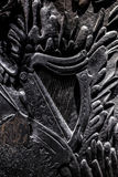 Sculpture on black painted wood! Stock Photos