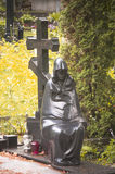 Sculpture of black mourning woman. Black mourning woman at slavic cemetery, Vilnius, Lithuania Royalty Free Stock Image