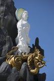 The sculpture of the Bodhisattva Avalokitesvara with the dragon in pagoda. MUI Ne, Vietnam Stock Image