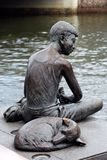Sculpture of boy & dog Stock Photos