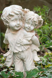 Sculpture of the boy and the girl Stock Images