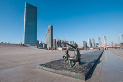 Sculpture of boy and girl in front of Xinghai Square Stock Image