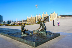 Sculpture of boy and girl in Xinghai square Royalty Free Stock Photography