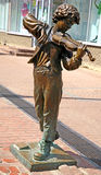 Sculpture Boy playing the violin Royalty Free Stock Photography