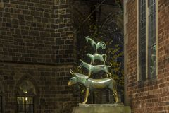 The sculpture of the Bremen town musicians by night. Central square of Bremen royalty free stock photos