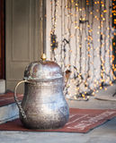 Sculpture of bronze teapot as entrace decoration in Bergamo town, Italy Stock Photos