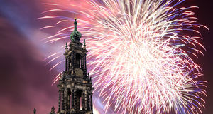 Sculpture on the Bruhl Terrace and  Hofkirche or Cathedral of Holy Trinity and holiday fireworks - baroque church in Dresden, Sach Royalty Free Stock Image