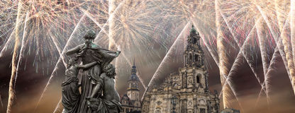 Sculpture on the Bruhl Terrace and  Hofkirche or Cathedral of Holy Trinity and holiday fireworks - baroque church in Dresden, Sach Stock Photo