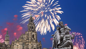 Sculpture on the Bruhl Terrace and  Hofkirche or Cathedral of Holy Trinity and holiday fireworks - baroque church in Dresden, Sach Stock Image