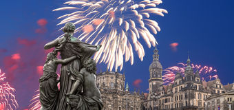 Sculpture on the Bruhl Terrace and  Hofkirche or Cathedral of Holy Trinity and holiday fireworks - baroque church in Dresden, Sach Stock Images