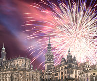 Sculpture on the Bruhl Terrace and  Hofkirche or Cathedral of Holy Trinity and holiday fireworks - baroque church in Dresden, Sach Royalty Free Stock Images