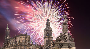 Sculpture on the Bruhl Terrace and  Hofkirche or Cathedral of Holy Trinity and holiday fireworks - baroque church in Dresden, Sach Royalty Free Stock Photography