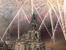 Sculpture on the Bruhl Terrace and  Hofkirche or Cathedral of Holy Trinity and holiday fireworks - baroque church in Dresden, Sach Royalty Free Stock Photos