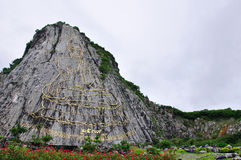 Sculpture of Buddha Image on mountain. The sculpture of Buddha Image on the cliff stock images