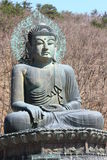 Sculpture of buddha. The sculpture of buddha among leafless tree on mountain royalty free stock photo