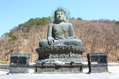 Sculpture of buddha. The sculpture of buddha among leafless tree on mountain Royalty Free Stock Photography