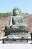Sculpture of buddha. The sculpture of buddha among leafless tree on mountain Stock Photos