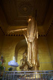 Sculpture of Buddha pointing to the foundation of  Mandalay sity. Interior of the Byar Deik Paye Pagoda on the Sacred Hill Stock Images