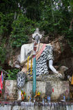 The sculpture of the Buddhist deity. At the entrance to the cave temple royalty free stock photos