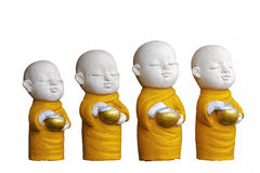 Sculpture Buddhist novice. Hold begging bowl royalty free stock image