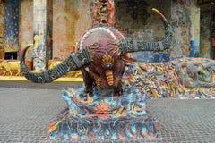 Sculpture of buffalo goddess. Running through blue flame stock image