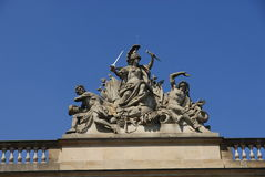 Sculpture on building. Under blue sky Stock Image