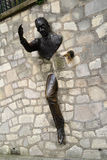 Sculpture called Le Passe-Muraille in Paris, France Stock Photos