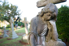 Sculpture on cemetery Stock Photos