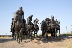Sculpture in Centennial Land Run Monument sunset, city Oklahoma USA. Group bronze sculpture in Centennial Land Run Monument sunset, city Oklahoma USA stock photos