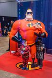 Sculpture of characters from movie Incredibles and two boys royalty free stock photo