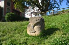 The sculpture of the chato. The sculpture of a head made of Sandstone, it is located at Candas, Asturias stock images