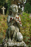 Sculpture. Of a child in a cemetery Stock Photography