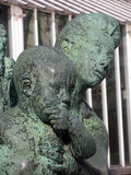 Sculpture of child and his mother Royalty Free Stock Photo