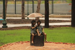 Sculpture of children in the Gorky Park. A rainy autumn day  in the Gorky Park in Kharkiv Stock Photography