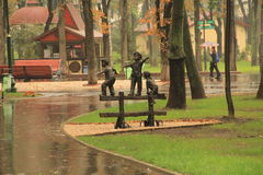 Sculpture of children in the Gorky Park. A rainy autumn day  in the Gorky Park in Kharkiv Stock Images