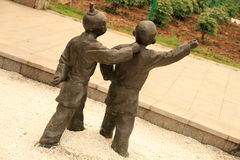 Sculpture of children Stock Images