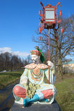 Sculpture of a chinese with a lantern on the Great Chinese Bridge on a sunny May day. Tsarskoe Selo Royalty Free Stock Photo