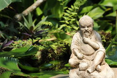 Sculpture. Chinese old man sculpture in the garden stock images