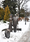 Sculpture in the city of Riga. A bronze man and lady with a chow chow dog Stock Photography