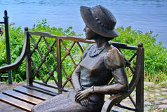 Sculpture closeup `Girl Summer Resident`. On the embankment of the Volga. Ples town is famous for its scenery. Golden Ring Stock Image