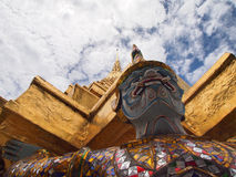 Sculpture of color full Ramayana Giant. Guard the gold pagoda under cloudy sky. the nice decorated Ramayana blue skin Giant is one of the character from Stock Image