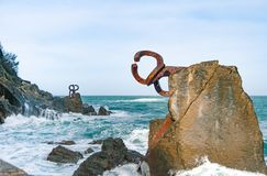 Sculpture `The Comb of the Wind` in the Basque Country of Spain. Sculpture `The Comb of the Wind` with giant scenic waves at the western end of the Bay in the Stock Photos