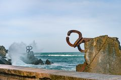 Sculpture `The Comb of the Wind` in the Basque Country of Spain. Sculpture `The Comb of the Wind` with giant scenic waves at the western end of the Bay in the Stock Photography