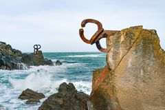 Sculpture `The Comb of the Wind` in the Basque Country of Spain. Sculpture `The Comb of the Wind` with giant scenic waves at the western end of the Bay in the stock photo