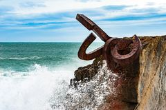 Sculpture The Comb of the winds in San Sebastian , Spain with sc. Sculpture The Comb of the winds in San Sebastian , Spain during stormy weather with scenic Stock Photo