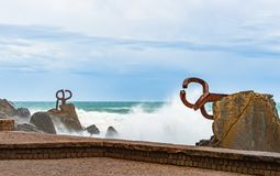 Sculpture The Comb of the winds in San Sebastian , Spain with sc. Sculpture The Comb of the winds in San Sebastian , Spain during stormy weather with scenic Stock Image