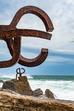 Sculpture The Comb of the winds in San Sebastian , Spain during. Stormy weather with scenic waves crushing upon stones Stock Photos